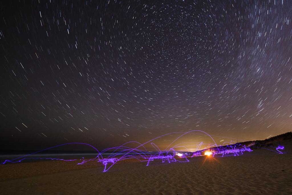 Luminous Frisbee Game at the Beach